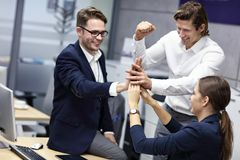 Group of business people celebrating success in office stock photos