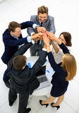 Group of business people celebrating their teamwork with a high Royalty Free Stock Images