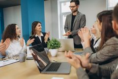Group of business people celebrating by throwing their business papers and documents fly in air, Power of cooperation, Success royalty free stock photos