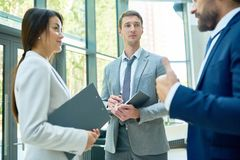 Group of Business People Chatting in Hall stock images