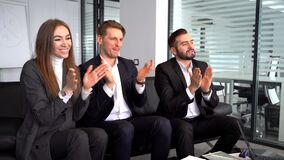 Handsome Business people clapping in modern office