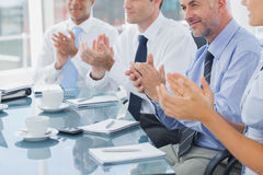 Group of business people clapping together Stock Photo