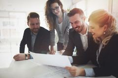 Group of business people collaborating in office. Group of business people collaborating on project  in office Royalty Free Stock Images