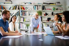 Group of business people collaborating on project in office. Group of business people collaborating on project in modern office stock image