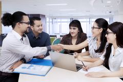 Group of business people come to an agreement during meeting.  Royalty Free Stock Photos