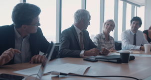 Group of business people in conference room stock footage