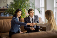 Group of business people congratulating their handshaking colleagues Stock Image