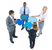 Group of Business People Connecting Jigsaw Puzzles royalty free stock photography