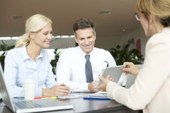 Group of business people consulting Royalty Free Stock Image