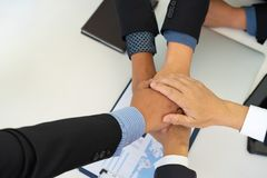 Group of business people coordinating hands after great meeting. stock images