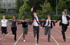 Group of Business People Crossing the Finish Line stock image
