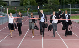Group of Business People Crossing the Finish Line Stock Images