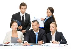 Group of business people debating Stock Images