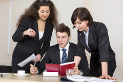 Group of business people discuss working schedule Stock Photography