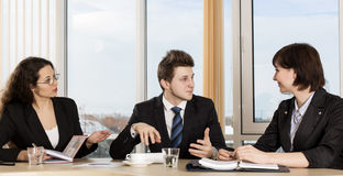 Group of business people discuss working schedule Royalty Free Stock Images