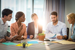 Group of business people discussing at desk Stock Photography