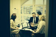 Group of business people discussing an important document. royalty free stock photography
