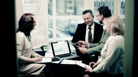 Group of business people discussing an important document. Office life stock photos