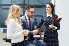 Group of business people discussing the latest details about the project in the office Stock Photos