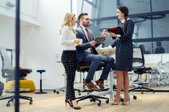 Group of business people discussing the latest details about the project in the office Stock Photo