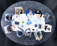 Group of Business People Discussing Statistical Analysis Royalty Free Stock Image