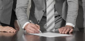 Business people sign up contract stock image