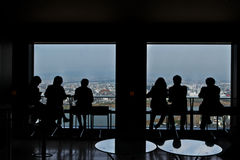 Group of business people enjoy view from skyscraper Royalty Free Stock Image