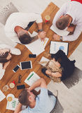 Group of business people exhausted sleep in office, top view Royalty Free Stock Photos