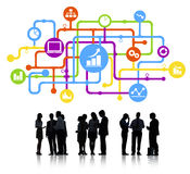 Group of Business People with Financial and Growth Symbols.  Stock Image