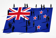 Group of Business People and the Flag of New Zealand Stock Image
