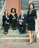 Group Of Business People In Front Of Building. Group of diversity business people. caucasian, african american, asian Stock Photo