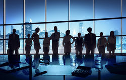 Group of Business People Gathered in the Office Stock Image
