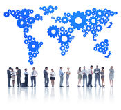 Group of Business People and Gear World Map Royalty Free Stock Photography