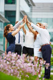 Group of business people giving high five Royalty Free Stock Photography