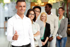Group of business people giving thumb up Stock Photos