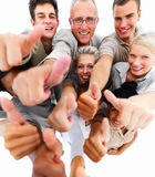 Group of business people giving thumbs up Stock Images