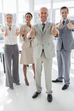 Group of business people giving thumbs up Stock Photography