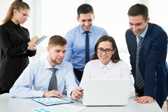 Group of business people. At a meeting around a table in a modern office Royalty Free Stock Images