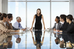 Group Of Business People Having Board Meeting Around Glass Table Royalty Free Stock Image