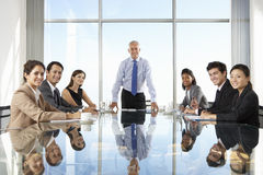 Group Of Business People Having Board Meeting Around Glass Table Royalty Free Stock Photos