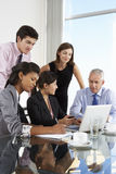 Group Of Business People Having Meeting Around Laptop At Glass T Stock Image