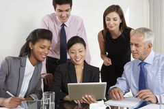 Group Of Business People Having Meeting Around Tablet Computer A Royalty Free Stock Photography