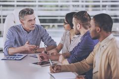 Group of business people having meeting in office royalty free stock image