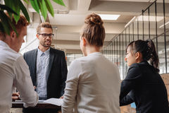 Group of business people having meeting together Royalty Free Stock Image