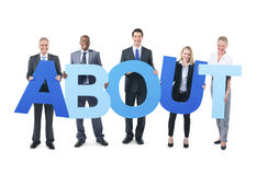 Group of Business People Holding ABOUT Royalty Free Stock Photos