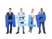 Group of business people holding the alphabet help stock photography