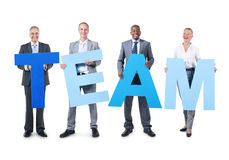 Group of Business People Holding the Alphabet royalty free stock photography