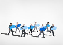 Group of Business People Holding the Arrow Sign Stock Photo