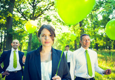 Group of Business People Holding Balloons. In the forest Stock Photo