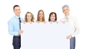 Group of business people holding a banner ad isolated on the white. Group of business people holding a banner ad isolated on white Stock Photos